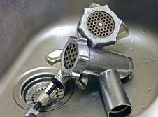 Two Meat Grinders In A Stainless Steel Sink Stock Image