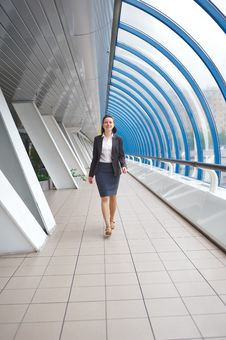 Free Modern Professional Businesswoman Walking Stock Image - 9829791