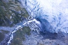Free Waterfall Flowing Under A Glacier Stock Images - 9830434