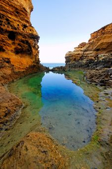 Free Water Reflection And Cliff Walls Stock Image - 9830721