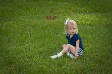 Free Little Girl Sitting In Grass Royalty Free Stock Photography - 9833217
