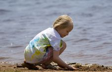 Child Playing At Beach Stock Image