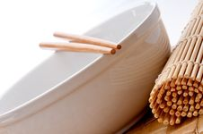 Free Of A Pair Of Chopsticks On A White Bowl Royalty Free Stock Photo - 9833885