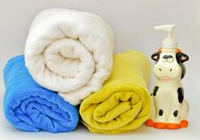 Pile Of Towels With A Liquid Soap Dispenser Royalty Free Stock Photo