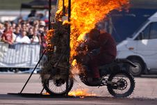 Free Stunt Rider And Wall Of Flames Royalty Free Stock Images - 9837089