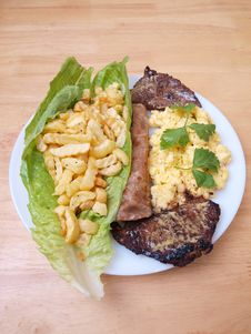 Free Beef Cutlets Salad Fries Eggs Bread One Stock Image - 9839661