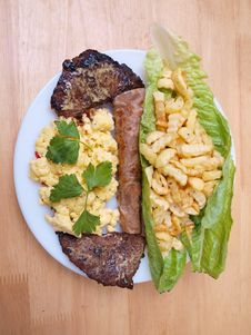 Free Beef Cutlets Salad Fries Eggs Bread Two Stock Photo - 9839680