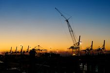 Free Sunset With Industrial Cranes In Silhouette Royalty Free Stock Photos - 98351668