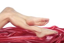 Beautiful Woman Legs And Feet Over Red Royalty Free Stock Image