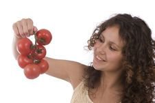 Woman With  Tomato. Royalty Free Stock Photography