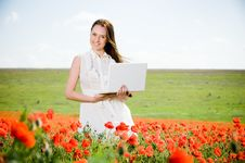 Free Smiling Beautiful Girl With Laptop Royalty Free Stock Photos - 9843588