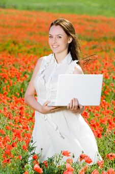 Free Smiling Girl With Laptop Royalty Free Stock Image - 9843606