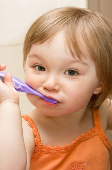 Free Baby Cleaning Teeth Stock Images - 9843864
