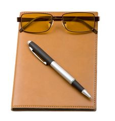 Free Daily Planner With Glasses  On White Stock Photos - 9844893