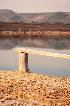 Free Bench Overlooking Lake Royalty Free Stock Photo - 9845455