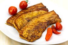 Free Roasted Belly Of Pork With Cherry Tomatoes Stock Image - 9846111