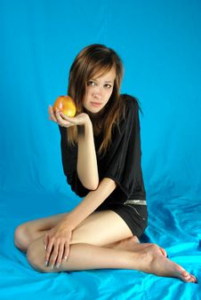 Girl With The Apple Stock Photos