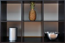 Ananas,can And Bowl In A Box Stock Photos