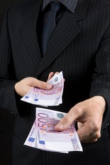 Free Businessman Holding Euros Stock Photos - 9847643