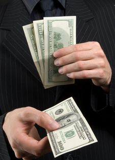 Free Businessman Holds Money In Hands Royalty Free Stock Photo - 9847645