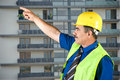 Free Mature Architect Pointing On Site Stock Image - 9856531