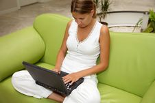 Free Young Woman Working On A Laptop Royalty Free Stock Images - 9851319