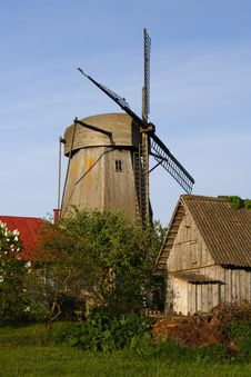 Free Windmill Behind Houses Royalty Free Stock Image - 9852346