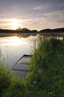 Free Sunrise On The Lake Royalty Free Stock Image - 9854756