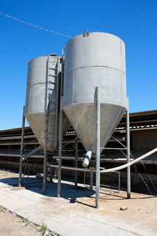 Free Two Gray  Tower Silos On Farm Stock Image - 9855161