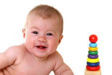 Free Happy Baby With Bright Toy Stock Image - 9856051