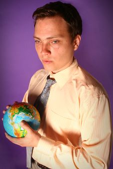 Businessman With Globe In His Hands Royalty Free Stock Photos
