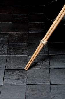 Free Chopsticks Resting On A Black Bowl Royalty Free Stock Photo - 9856385