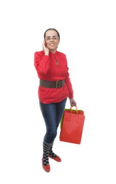 Lady In Red Talking By Phone Royalty Free Stock Photography