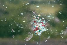Free Exploding Glass With Colored Buttons Royalty Free Stock Images - 98537059
