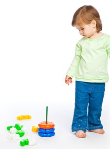 Free Little Girl With Toys Royalty Free Stock Photography - 9861407