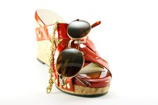 Red Shoe With Sunglasses And Bracelet Royalty Free Stock Photos