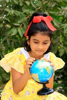 Free Girl Exploring The Globe Royalty Free Stock Image - 9865256
