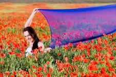 Free Smiling Girl In The Poppy Field Stock Photography - 9866102