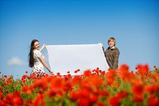 Lovely Couple In The Poppy Field Stock Photos