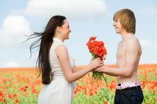 Free Lovely Couple In The Poppy Field Stock Photography - 9866142