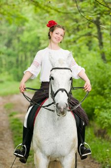 Free Smiling Girl Riding Horse Royalty Free Stock Photos - 9867148