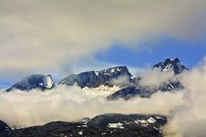Free Rustic View Of Mountains With Clouds In The Yukon Stock Images - 9867234