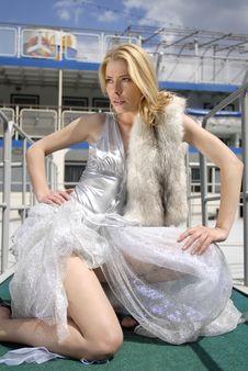 Blonde Girl On Boarding Bridge Stock Photography