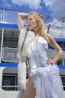 Pretty Blonde Girl On Boarding Bridge Royalty Free Stock Images