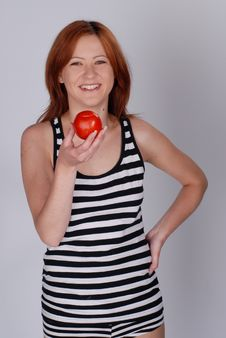 Girl With Tomato Stock Photo