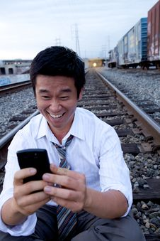 Free Cell Phone Call On Train Tracks Royalty Free Stock Photography - 9869647