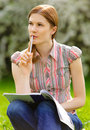 Free Pretty Girl Studying Outdoors Stock Photo - 9875850