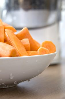 Free Carrots Preparing For Juicer Stock Photos - 9875083