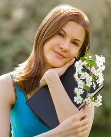 Free Pretty Girl With A Book Outdoors Stock Photo - 9875880