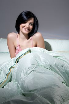 Free Woman, Blanket And Pillows Stock Images - 9876984